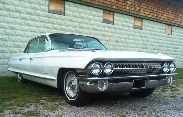 The 1961 Cadillac Series 62 was purchased off of Embay and delivered the week of the couple's honeymoon.