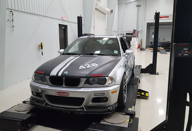 Notice the top of the tire on this BMW race car is closer to the body than the bottom of the tire, indicating that it's running negative camber for increased traction.